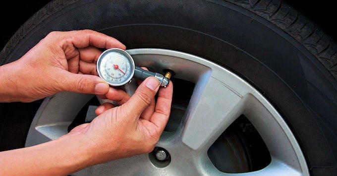 Checking a car's tire pressure