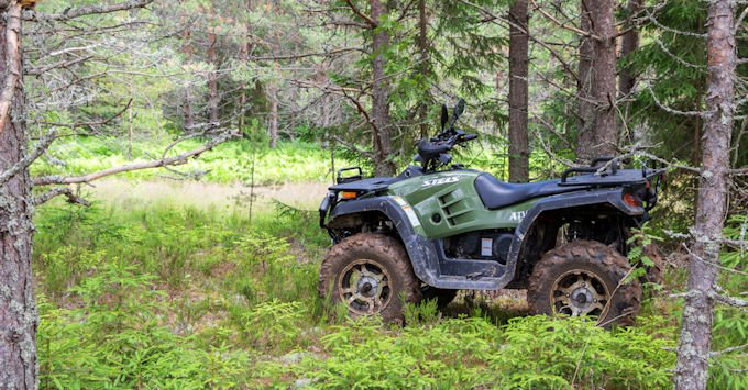 An ATV in the woods