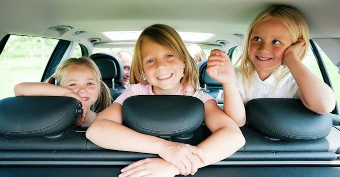 Three girls in the back of an SUV